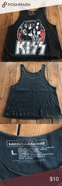 KISS tank top. Worn once! KISS band tank top! Size L. It was only worn once! Feel free to make me an offer!  Tops Tank Tops