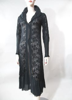 circa 1920 Liberty & Co silk chiffon and silk lace evening jacket. Dramatic and sultry, this fine quality vintage jacket has finely pleated ruffles trimming the flouncy collar and cuffs, beautiful floral-patterned laces joined with ladderwork to the diaphanous chiffon and elegantly shaped and fitted long sleeves. The silhouette is very dynamic and sculptural with showy construction patterns and great textural interest in the combination of lace and chiffon and one can imagine many uses for…