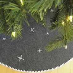 Lace could easily be sewn around the edge instead of crocheting......Make a simple yet striking christmas tree skirt with just a little crochet and embroidery.