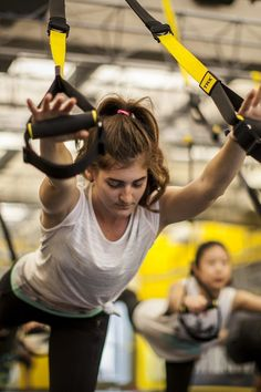 """Welcome to the """"TRX full-body circuit party!"""" This badass gym workout was brought to you by Michelle Opperman, regional group fitness director for"""
