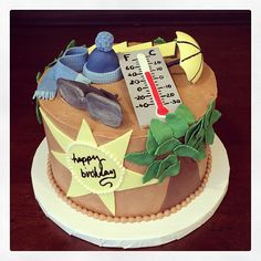 This birthday cake is for a guy completely addicted to the wearer report. Since we had no idea what the NYC weather would be like today, we included a scarf and hat, just in case.... Photo by Sugar Flower Cake Shop. www.sugarflowercakeshop.com