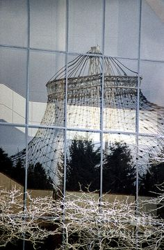 The Pavilion in Riverfront Park, reflected in the windows of the Opera House.  Spokane Washington