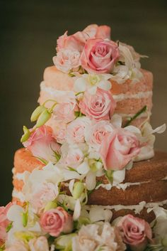 Featured Photographer: Cristina Navarro Photography; Adorable pink flower covered wedding cake