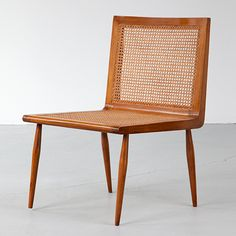 """Joaquim Tenreiro, Brazil  Low Bedroom Chair in caviona with woven cane seat and back. (seat: 15"""" H)        19.5"""" L x 20"""" W x 30"""" H  /  49.53cm L x 50.80cm W x 76.20cm H  LC992"""