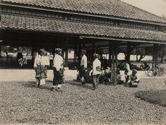 "West Java. Angklungs (musical instruments) Bandoeng, ""Boentjis"" (with angklungs)."