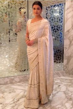 Beautiful white sari worn by Aishwarya Rai from the House of Kotwari collection. Love the fine pearl work on the sari and beautifully accessorized by her. Mangalore, Indian Look, Indian Ethnic Wear, Bollywood Saree, Bollywood Fashion, Saree Fashion, Indian Dresses, Indian Outfits, Indische Sarees