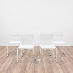 This set of 4 patio chairs are featured in a durable metal with a fresh white finish. These outdoor chairs are in great condition with simple straight legs, a woven back and square seat. Sleek and modern chairs perfect for dining on a patio or porch! #contemporary #chairs #chair #sandiegovintage #vintagefurniture