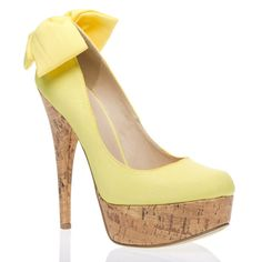Eek!  I think I need a pair of yellow shoes...with bows...and cork heels...OH MY!