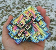 This is a pure bismuth crystal. The heaviest element that is not radioactive (ok technically it is but it's half life is like 9 orders of magnitude older than the universe so it really doesn't count.) Probably my favourite crystal structure, even if you forget the colour. Surprisingly, bismuth is also super-not-toxic. You can actually eat the stuff and it's often in indigestion remedies. Fascinating element, all round.