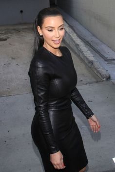 Reality TV babe Kim Kardashian is all smiles and sexy in black as she greets fans after filming a show in Hollywood.