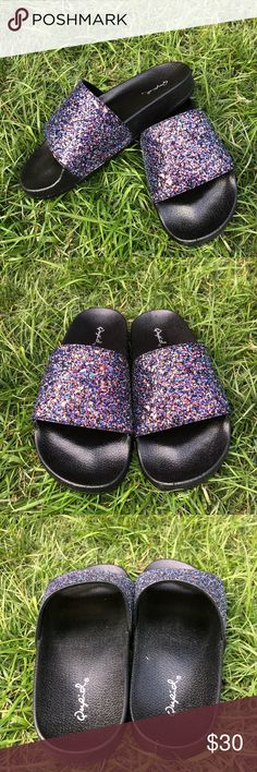Women's Black Glitter BooBoo Slide sandals Brand new  With box 📦 Black Glitter BooBoo Slide  PRODUCT DESCRIPTION: All eyes will be on your feet when sliding into these sandals featuring trend-savvy details.  Man-made Imported Qupid Shoes Sandals