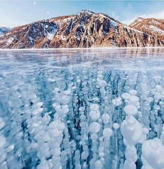 Russian photographer captures stunning images of frozen Lake Baikal, the oldest and deepest lake in the world