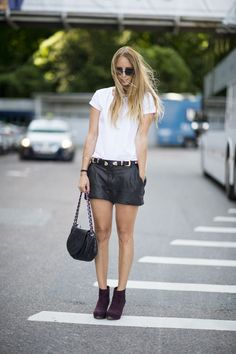 Black leather shorts with a white tee