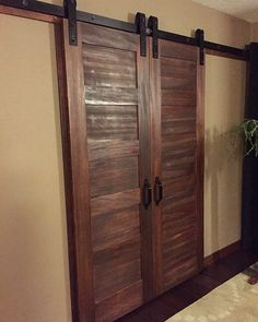 Bedroom walk-in closet doors! Love the 5 panel doors with Rusticas barn door slider hardware! Very happy! -Connie Fauver