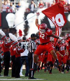 (Trent Nelson  |  The Salt Lake Tribune)  Utah Utes defensive tackle Sam Tevi (32) plants a flag pre-game as the University of Utah hosts Utah State, college football Thursday, August 29, 2013 at Rice-Eccles Stadium in Salt Lake City.