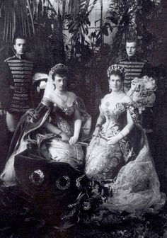 Grand Duchess Anastasia, wearing the tiara in the previous pin with a material kokoshnic under it. Seated with Grand Duchess Vlad, who, with Anastasia's mother, arranged a marriage to Grand Duchess Vlad's elder brother, Frederich Francis III of Mecklenburg-Schwerin. The couple married on 24 January 1879. Anastaisa didn't want the marriage, but was given no choice in it.