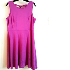 "Eloquii 14 Lilac Sleeveless Skater Dress This Eloquii 14 Lilac Sleeveless Skater Dress is in great used condition. No pilling. Great back details! Fit and flare style in purple-ish-pink fabric of 65% rayon, 30% poly, 5% spandex, has some stretch. Back zip. Bust measures 20.5"" across laying flat, measured from pit to pit, so 41"" around unstretched. 39"" long. ::: Bundle 3+ items from my closet and save 30% off when you use the app's Bundle feature! ::: No trades. Eloquii Dresses"