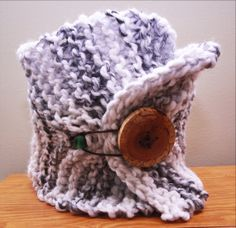 Make someone's hike a little warmer with this cozy wool blend birch tree cowl. This cowl is hand knitted with snuggly wool blend yarn in tones of white, grey and black. This cowl is finished with a leather cord, cherry wood buttons and a dark stained wooden bead. This cowl is about 12 inches high and 26 inches long when it is unstretched.