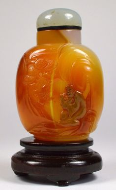 A fantastic carved Chinese shadow agate snuff bottle,  scholar in treed landscape