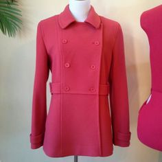 """Rare salmon red color wool & cashmere blend pea coat. Really warm, very dense wool. For a short coat, it's heavier than it looks. Gorgeous construction. Angled slit pockets. Fully lined. Beautiful cond, well cared for, and it's freshly dry cleaned. Approx measurements: U-U 21.5"""", S-S 16"""", under seam slv length 18.5"""", slv length from collar seam 30.5"""". My favorite color, but it's just lounging in my closet! LMK if you have any questions, and thanks for visiting my closet!"""