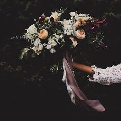 I love everything about this bouquet, and would love to keep a running theme of roses throughout the design!