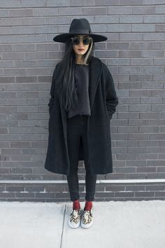 Nadia... guru. total blackout. NYC. #NadiaSarwar #FrouFrouu Total black as always with long jacket, a big hat and red socks for the contrast. http://believeinmystyle.weebly.com/fashion.html