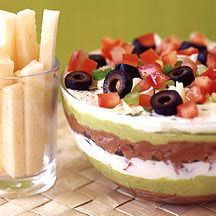 Layered Mexican Bean Dip  Suggest using pre made guacamole, mix spices with the beans.