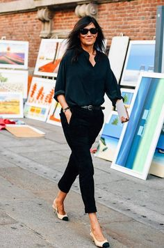 Editor-in-Chief of Vogue Paris, Emmanuelle Alt's paired back look proves that sometimes less is more - black on black and Chanel pumps are French girl chic at it's finest. Captured by the original street style photographer, Tommy Ton at Milan fashion week, exclusively for Style.com #styledotTon