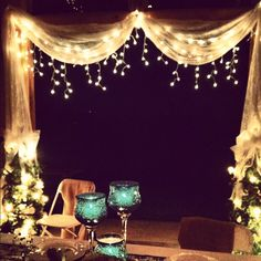 Lace curtains twinkle icicle lights make the barn so much more romantic.