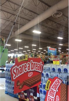 This picture allows viewers to see the extendable MagPole installation process. Snack Recipes, Snacks, Retail Stores, Hanging Signs, Pop Tarts, Packaging, Food, Snack Mix Recipes, Appetizer Recipes