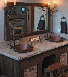 Website Picture Gallery Very rustic bathroom The stone countertops with the wooden cupboards give the room the rustic style The copper metal sinks give the room a nice touch