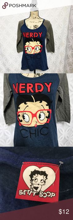 "Betty Boop Nerdy Chic Baseball 3/4 Sleeve Tee NWOT Betty Boop Nerdy Chic Baseball 3/4 Sleeve Tee NWOT.            ⚡️Measurements Laying Flat Size M Armpit to Armpit 17"" Shoulder to Hem 24"" Bundle to Save 🤓 Sorry NO outside transactions 🚫 NO trades 🚫 Happy Poshing 🦋 Offers welcomed 👍 NO Low balling 👎👎 ⚡️All items from a pet 😼and Smoke Free Home Betty Boop Tops Tees - Long Sleeve"
