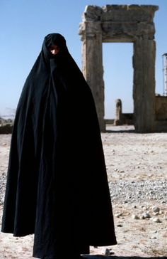 A woman wearing a full length black Chador at the Fars Province of Persepolis in Iran