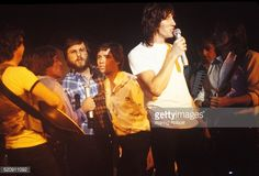 NEW YORK - FEBRUARY 27: (L-R) Four backup vocalists and backup acoustic guitar player with singer, songwriter, bassist and composer Roger Waters (holding microphone) and guitarist, singer, songwriter and multi-instrumentalist David Gilmour of the British progressive and psychedelic rock band Pink Floyd performing at 'The Wall' concert tour on February 27, 1980 at Nassau Coliseum in Long Island, NY. (Photo by Waring Abbott/Getty Images)