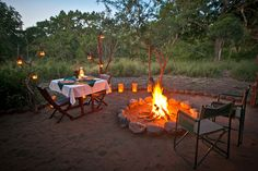Romantic bush dining in the Zululand Rhino Reserve, South Africa.
