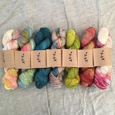 yesterday i packed up lots of yarn destined to be knit into @dreareneeknits #findyourfadeshawl 's and i thought you'd like to see some of the colourways. this gorgeous shawl takes seven colours so for the next seven days I will share a different scheme with you. today from left to right is: i see seashells wildflowers teal tide pressed flowers citron rhubarb and orchid. you can also view this on my website blog - fade on!