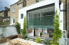 This innovative large scale modern sash window provides light to a split level living and kitchen area to the rear of this terrace house. Victorian Terrace House, Sash Windows, Scale, Modern, Kitchen, Travel, Weighing Scale, Trendy Tree, Cooking