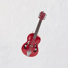 This miniature guitar is so cute, It's on my wish List!