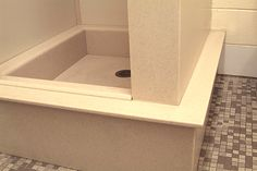 solid surface shower base installation