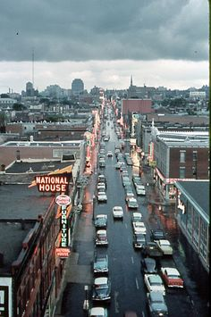 Rue Sainte-Catherine, Montreal, Quebec. This is a vintage photo - there are English signs on this street. Now they are all francais.