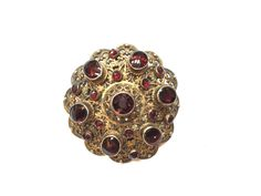ANTIQUE SILVER AUSTRO-HUNGARIAN PIN-BROCH DECORATED WITH LARGE GARNETS GILDED.