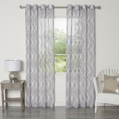 @Overstock - Sheer Moroccan Grommet Top 84-inch Curtain Panel Pair - These delicately sheer curtains will be a great modern addition to any room. A marvelous Moroccan print in muted tones combines with a durable polyester construction for a perfect everyday accent to your home.  http://www.overstock.com/Home-Garden/Sheer-Moroccan-Grommet-Top-84-inch-Curtain-Panel-Pair/9422521/product.html?CID=214117 $69.99
