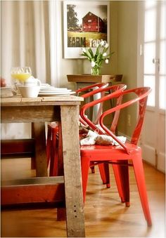 Love the pop of Coral/red color chairs in this Urban Cottage Chic Kitchen Dining Area!  Farmhouse table with red chairs, designed by Stephen Saint-Onge via @Centsational Girl