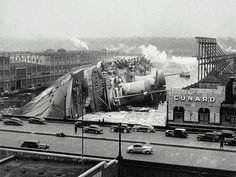 The S.S. Normandie capsized after going up in flames in New York harbour, 1942