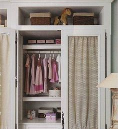 This soft gray built-in armoire features gathered fabric to conceal hanging clothes and lined baskets.  Fabric could also be used to hide electronic equipment, allowing it to breathe and without blocking infrared remote access.