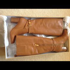Brand new MKors boots with gold detail. Perfectly stylish for the winter! Neutral color and gold accents will add glamour to any outfit. Final two pictures courtesy of Google. No trades please. Michael Kors Shoes Heeled Boots