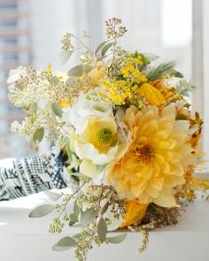 These are our favorite yellow wedding bouquets. Learn more about flowers that typically come in this sunny hue, plus how to use them in your big-day bouquet. Yellow Wedding Flowers, Yellow Flowers, Blue Wedding, Daffodil Wedding, Yellow Weddings, Summer Wedding, Wedding Colors, Pieris Japonica, Bouquet Champetre