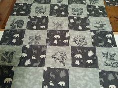 Gray wildlife quilt.