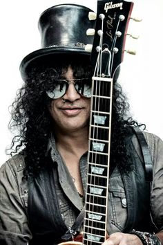 Best known as the former lead guitarist of the famous American hard rock band 'Guns N' Roses', SLASH (Saul Hudson) Rock And Roll, Pop Rock, Slash Guns N Roses, Guns And Roses, Hard Rock, Impression Poster, Music Rock, Rock Legends, Hollywood Walk Of Fame