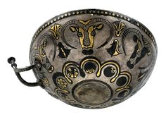 14th century B.C. silver bowl from Egkomi on Cyprus. It's decorated with bulls' heads and floral motifs of Late Bronze Age. Courtesy of the Cyprus Archaeological Museum.
